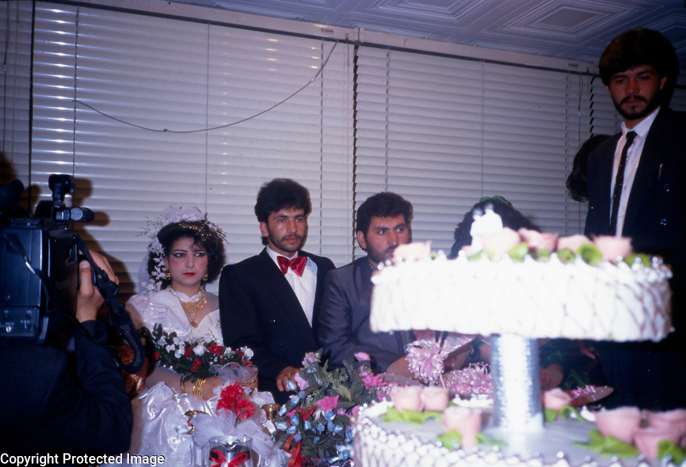 1974<br /> Weddings have always been a highlight in the life of every family. Traditionally, weddings were held in the home, but during the 1970s it was fashionable to celebrate weddings in hotels. The elite gravitated to the newly opened Intercontinental Hotel, the most elegant venue at that time. The less affluent held their weddings in small, modest but modern hotels that were opening up in the vicinity of Shahr-i-Naw. Western-style white wedding dresses came into fashion in the 1900s, introduced by Khayria Tarzi when she married Prince Enayatullah in 1909 at the Qawm-i-Bag. Since 2001 enormous wedding halls, their facades drenched with cascades of millions of colored, flashing lights, have spread over every part of Kabul. Often several thousand guests attend.