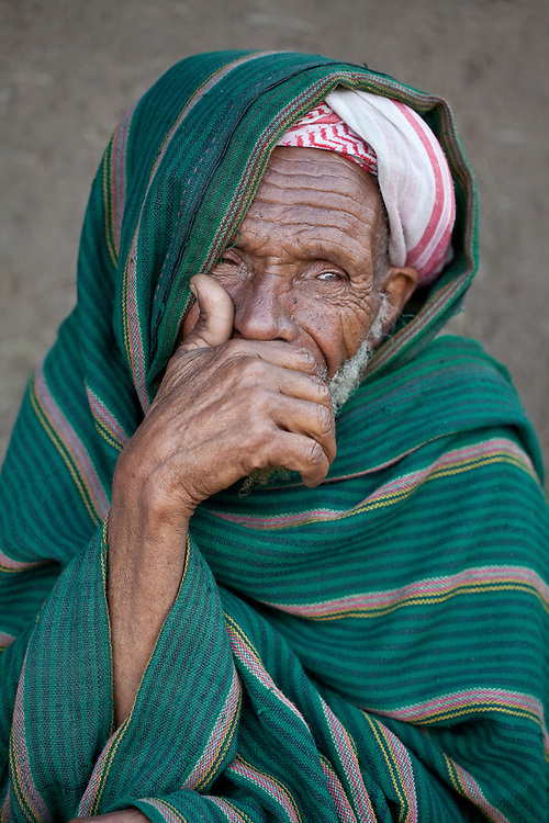 A muslim man covers his mouth in Dinsho, a small town nestled in the Bale Mountains of Ethiopia
