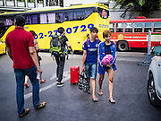 """03 JANUARY 2017 - BANGKOK, THAILAND:        People walk into the Ekkamai Bus Station to get on a bus heading out of Bangkok. Travelers flocked to Bangkok bus and train stations Tuesday, the last day of the long New Year's weekend in Thailand. The New Year holiday in Thailand is called the """"seven deadly days"""" because of the number of fatal highway and traffic accidents. As of Monday Jan 2, 367 people died in highway accidents over the New Year holiday in Thailand, a 25.7% increase over the same period in 2016.    PHOTO BY JACK KURTZ"""