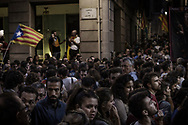 Catalan independence supporters gather in streets near Palau de la Generalitat, the Catalan Government building,  to celebrate the Parliament vote for independence from Spain, on October 27, 2017 in Barcelona, Spain.