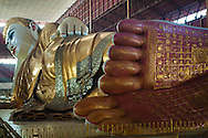 The Chauk Htat Gyi Pagoda is famous for its huge reclining Buddha, built in 1966 replacing the old image built in 1907 by Sir Hpo Thar which suffered damage due to climate over the years. The reclining Buddha measures 65 meters in length.  Monasteries in the vicinity of the pagoda accommodate over six hundred monks who study Buddhist Scriptures from senior and qualified monks. The entire cost of maintenance comes from donations.