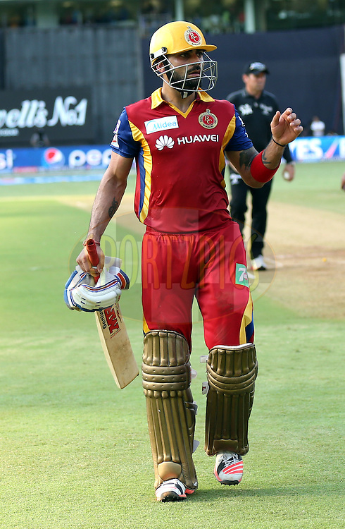 Royal Challengers Bangalore captain Virat Kohli walsk back after the first innings of the match 46 of the Pepsi IPL 2015 (Indian Premier League) between The Mumbai Indians and The Royal Challengers Bangalore held at the Wankhede Stadium in Mumbai, India on the 10th May 2015.<br /> <br /> Photo by:  Sandeep Shetty / SPORTZPICS / IPL