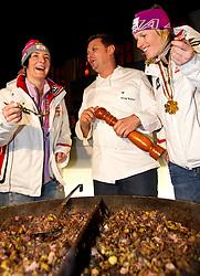 19.02.2011, Haus Austria, Garmisch Partenkirchen, GER, FIS Alpin Ski WM 2011, GAP, Siegerparty Haus Austria, im Bild silber Medaille Kathrin Zettel (AUT) verkosten ein Tiroler Gröstl, Gold Medaille und Weltmeister Marlies Schild (AUT) // silver medal Kathrin Zettel (AUT), Gold Medal and World Champion Marlies Schild (AUT) 4during winners party Haus Austria Fis Alpine Ski World Championships in Garmisch Partenkirchen, Germany on 19/2/2011. EXPA Pictures © 2011, PhotoCredit: EXPA/ J. Groder
