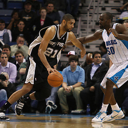 Mar 01, 2010; New Orleans, LA, USA; San Antonio Spurs center Tim Duncan (21) drives past New Orleans Hornets center Emeka Okafor (50) during the second half at the New Orleans Arena. The Spurs defeated the Hornets 106-92. Mandatory Credit: Derick E. Hingle-US PRESSWIRE