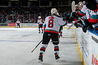 KELOWNA, BC - DECEMBER 30:  Trevor Wong #8 of the Kelowna Rockets skates past the bench to fist bump in celebration of a first period goal against the Prince George Cougars at Prospera Place on December 30, 2019 in Kelowna, Canada. (Photo by Marissa Baecker/Shoot the Breeze)
