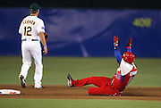 MEXICO CITY - MARCH 10: Designated hitter Michel Enriquez #12 of Cuba slides into second base during the Pool B, game four against Australia in the first round of the 2009 World Baseball Classic at Foro Sol Stadium in Mexico City, Mexico, Tuesday March 10, 2009. Cuba defeated Australia 5-4. (Photo by Paul Spinelli/WBCI/MLB Photos) *** Local Caption *** Michel Enriquez
