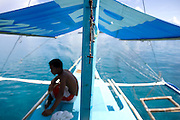 Boracay home to beautiful white sands and crystal clear blue water is one of the pearl resorts of the Philippines. Tourist from around the world come to enjoy this tropical paradise...Photo by Jason Doiy.6-12-08