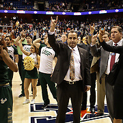 Head coach Jose Fernandez, (center), USF, and his team after their loss during the UConn Huskies Vs USF Bulls Basketball Final game at the American Athletic Conference Women's College Basketball Championships 2015 at Mohegan Sun Arena, Uncasville, Connecticut, USA. 9th March 2015. Photo Tim Clayton