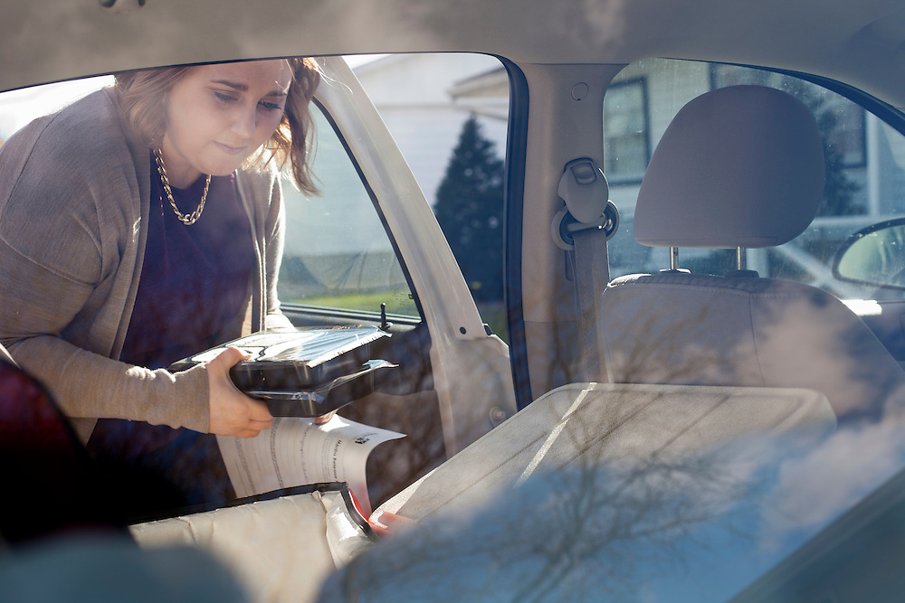 Horizons volunteer coordinator Anna Ronnebaum retrieves a Meals on Wheels lunch from the back of her car at a stop on her route in Cedar Rapids on Thursday, November 19, 2015. The Meals on Wheels program is funded by the federal government through the Older Americans Act, which was passed by congress fifty years ago to support the health and independence of senior Americans. Horizons estimates that it serves 800 meals per day, seven days a week. (Rebecca F. Miller/Freelance for The Gazette)