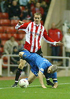 Photo. Andrew Unwin<br /> Sunderland v Cardiff City, Nationwide League Division One, Stadium of Light, Sunderland 14/10/2003.<br /> Cardiff's Graham Kavanagh is brought down by Sunderland's Jeff Whitley.