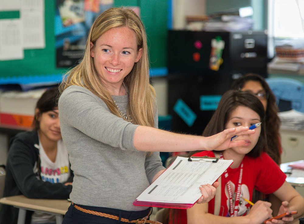 First year teacher Natalie Nelson works with her Advanced Placement government students at Chavez High School, May 21, 2014.