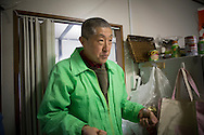 Yuetsu Taira, 56 years old, are living with his mother Tsuyako Taira, 80 years old  in a temporary house in Ishinomaki, Japan