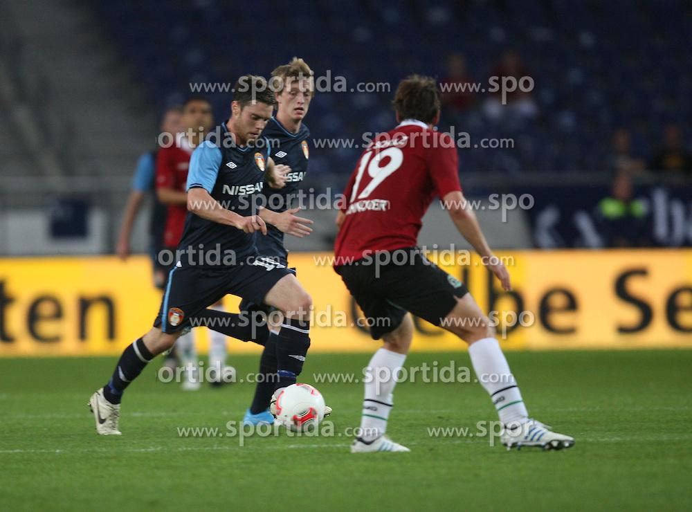 FootballL: Europa League, Qualification, Hannover 96 - St. Patricks Athletic, Hannover, 09.08.2012..John Russel (St. Patricks, l.) - Christian Schulz (Hannover)..©pixathlon