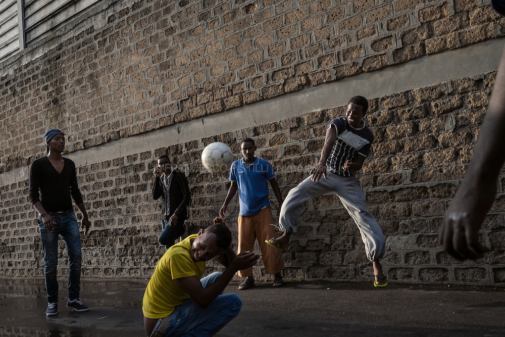 Young migrants resqued from boats in Sicily are now playing a strange volleyball game just outside Baobab Center, in Rome.