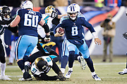 NASHVILLE, TN - DECEMBER 31:  Marcus Mariota #8 of the Tennessee Titans runs the ball and gets away from the tackle of Malik Jackson #97 of the Jacksonville Jaguars at Nissan Stadium on December 31, 2017 in Nashville, Tennessee.  The Titans defeated the Jaguars 15-10.  (Photo by Wesley Hitt/Getty Images) *** Local Caption *** Marcus Mariota; Malik Jackson