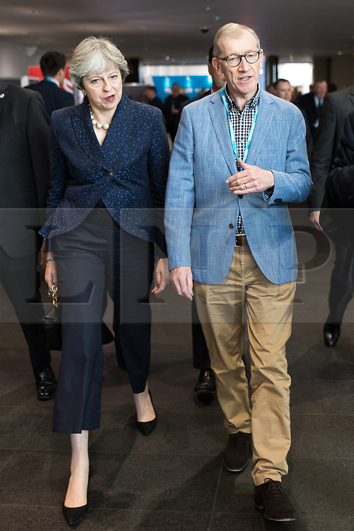 © Licensed to London News Pictures . 02/10/2017. Manchester, UK. THERSA MAY and PHILIP MAY leave the conference hall after Philip Hammond's speech , during the second day of the Conservative Party Conference at the Manchester Central Convention Centre . Photo credit: Joel Goodman/LNP