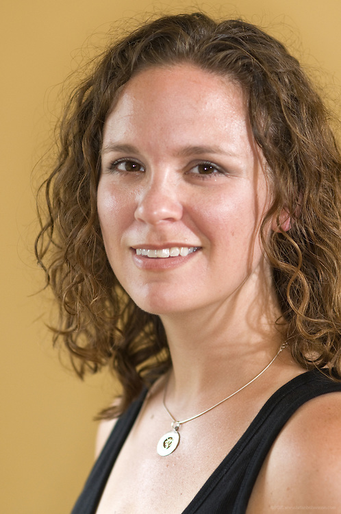 Jodie Tingle-Willis, proprietor of Supreme Peace Yoga, Wednesday, July 20, 2011 at her home studio in the Beechmont neighborhood in Louisville, Ky. (Photo by Brian Bohannon)