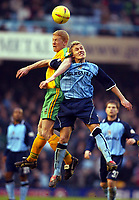 Photo: Scott Heavey.<br />Coventry v Norwich. Nationwide Division One. 14/02/2004.<br />Gary Holt beats Craig Pead in the air