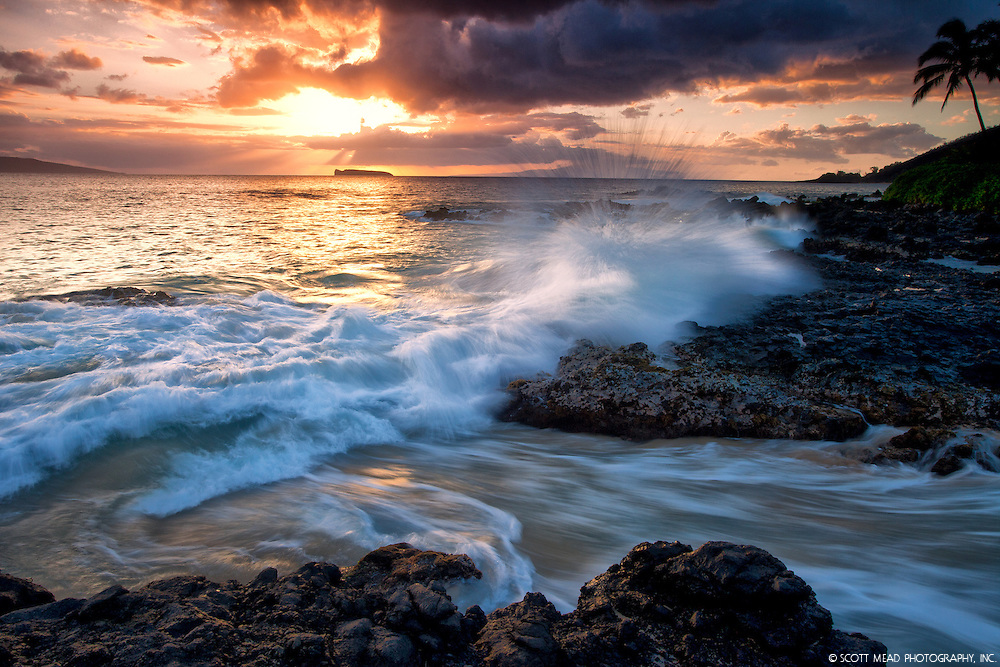Splashing, crashing wave from Secret Beach, Wedding Beach, Makena Cove, at sunset, with view of Molokini, from Wailea, Maui, Hawaii
