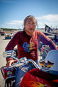 Portrait of a Korean man sitting on his Harley Davidson motorbike at the harbour in Jukbeon - located at the South Korean East Coast.