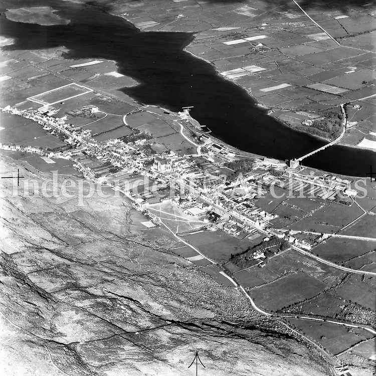 A78 Cahirciveen.   09/01/53 (Part of the Independent Newspapers Ireland/NLI collection.)<br /> <br /> <br /> These aerial views of Ireland from the Morgan Collection were taken during the mid-1950's, comprising medium and low altitude black-and-white birds-eye views of places and events, many of which were commissioned by clients. From 1951 to 1958 a different aerial picture was published each Friday in the Irish Independent in a series called, 'Views from the Air'.<br /> The photographer was Alexander 'Monkey' Campbell Morgan (1919-1958). Born in London and part of the Royal Artillery Air Corps, on leaving the army he started Aerophotos in Ireland. He was killed when, on business, his plane crashed flying from Shannon.