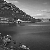 Black and white rural scene with lake and mountains