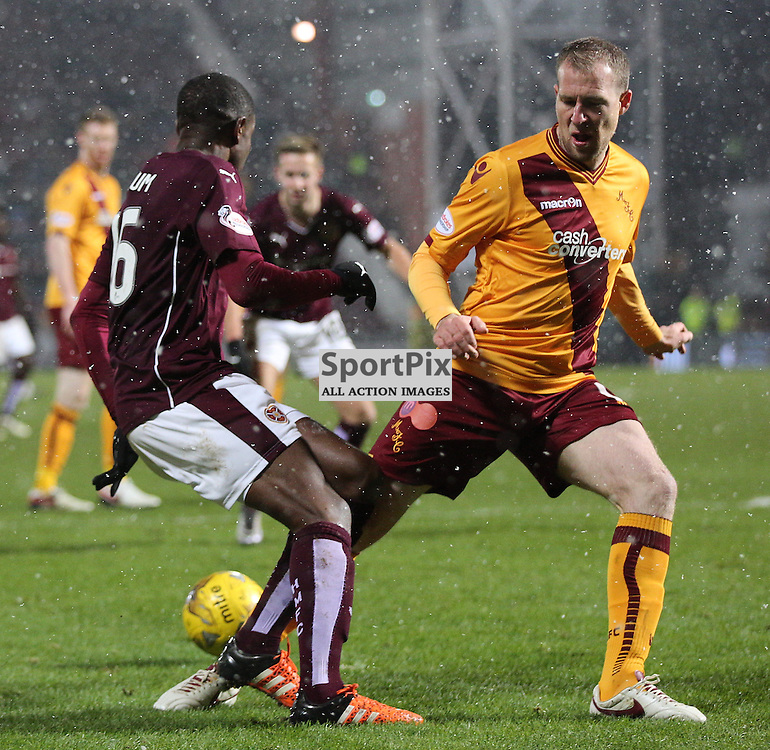 Hearts v Motherwell Scottish Premiership 16 January 2016; Arnaud Djoum (Hearts, 16) is brought down by David Clarkson (Motherwell, 19) for a penalty to Hearts during the Heart of Midlothian v Motherwell Scottish Premiership match played at Tynecastle Stadium, Edinburgh; <br /> <br /> &copy; Chris McCluskie | SportPix.org.uk