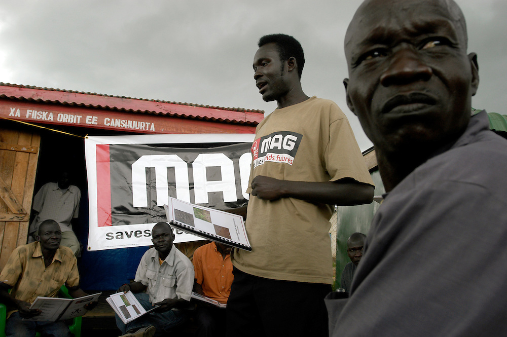 A Community Liaison team from Mines Advisory Group (MAG) giving mine risk education and security measures to truck drivers entering South Sudan from Uganda in the customs yard at the border..Kaya, South Sudan. 10/10/2009..Photo © J.B. Russell