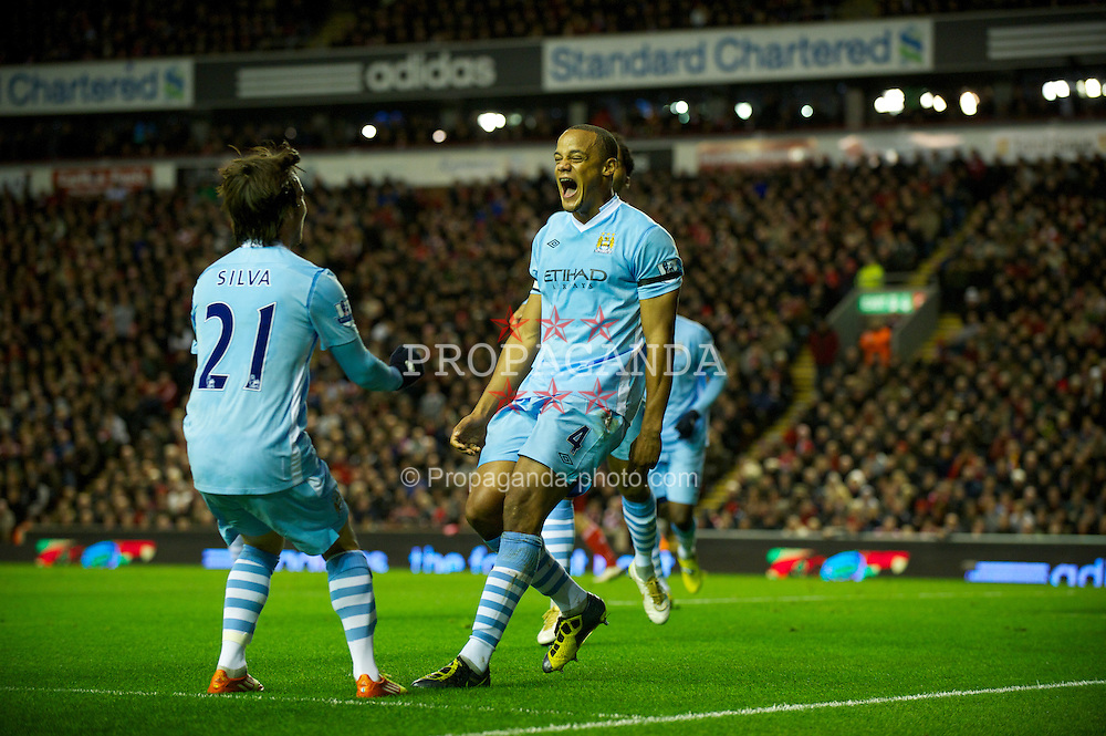 LIVERPOOL, ENGLAND - Sunday, November 27, 2011: Manchester City's Vincent Kompany celebrates scoring the first goal against Liverpool with team-mate David Silva during the Premiership match at Anfield. (Pic by David Rawcliffe/Propaganda)