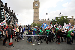 Licensed to London News Pictures 17/10/2013<br /> London. UK <br /> Teachers on strike march past the Houses of Parliament, whilst protesting against the government's decision to not give teachers a pay rise. <br /> Photo credit: Anna Branthwaite/LNP