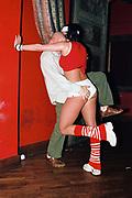 A man squeezing a dancers bottom at Funktup, December 2004