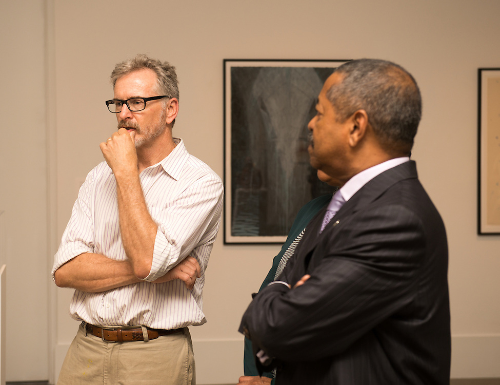 President Roderick McDavis (Right) speaks with artist Rob Hartshorn about his painting at the Kennedy Museum. Photo by Ben Siegel/ Ohio University