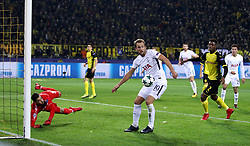 Tottenham Hotspur's Harry Kane (centre) and Borussia Dortmund goalkeeper Roman Burki (left) in action