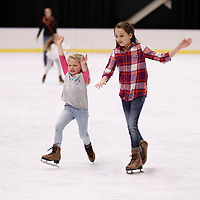 Thomas Wells | BUY at PHOTOS.DJOURNAL.COM<br /> Madalynn Hays, 8, left, and Maleah Nickoles, 11, try to stay up as they make their way to the exit after a few laps around the rink.