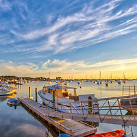 Picturesque New England photography of Scituate Harbor in Scituate Massachusetts. The sunrise golden hour light beautifully painted this harbor scenery in warm hues and colors.<br />