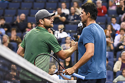 October 4, 2018 - St. Louis, Missouri, U.S - ANDY RODDICK and MARK PHILIPPOUSSIS shake hands after their match during the Invest Series True Champions Classic on Thursday, October 4, 2018, held at The Chaifetz Arena in St. Louis, MO (Photo credit Richard Ulreich / ZUMA Press) (Credit Image: © Richard Ulreich/ZUMA Wire)