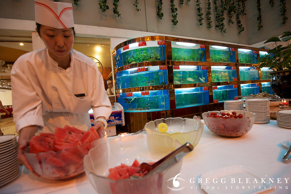 Stage 2's Dragon Spring Hotel, Chefs have been trained to cook pasta and rice for the athletes in lieu of aquatic delights pulled live from fish tanks adorning the wall -- 133.5km from the Bird's Nest in Beijing to Mentougou via North Gate of Summer Palace. 2011 Tour of Beijing Scouting Photos