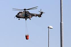 Helikopter gasi pozar pri Divaci, August 4, 2017. Photo by Urban Urbanc / Sportida