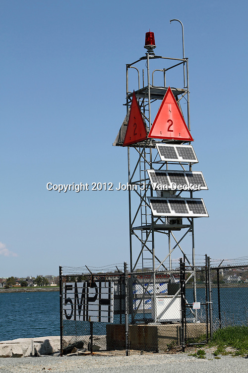 A US Coast Guard navigational aid in Newport, Rhode Island, USA. The structure uses solar panels for energy.
