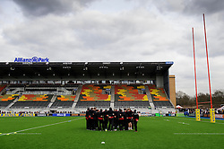 Saracens players huddle on their new pitch ahead of the match - Photo mandatory by-line: Rogan Thomson/JMP - Tel: Mobile: 07966 386802 16/02/2013 - SPORT - RUGBY - Allianz Park - Barnet. Saracens v Exeter Chiefs - Aviva Premiership. This is the first Premiership match at Saracens new home ground, Allianz Park, and the first time Premiership Rugby has been played on an artificial turf pitch.