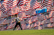 A girl works out amongst 3,000 US flags are displayed at Pepperdine University to mark the 12th anniversary of the 9/11 terror attack, September 10, 2013 in Malibu, California. Photo by Ringo Chiu/PHOTOFORMULA.com)