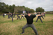 David Mayberry and his classmates joke around with exaggerated safe calls and karate kicks on final day of Umpire School.