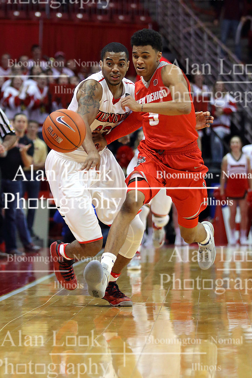 03 December 2016:  Deontae Hawkins(23) and Jalen Harris reach for a loose ball near the out of bounds line during an NCAA  mens basketball game between the New Mexico Lobos the Illinois State Redbirds in a non-conference game at Redbird Arena, Normal IL
