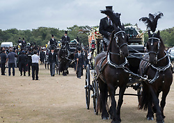 © Licensed to London News Pictures. 04/09/2016. London, UK.  A horse drawn cortege leaves Winn's Common Park after a funeral service was held for five men who drowned at Camber Sands last month.  The five men: Kurushanth Srithavarajah, brothers  Kenigan and Kobi Nathan, Inthushan Sri and Nitharsan Ravi were all friends from London.  They got into difficulty in the sea of Camber Sands on August 24. Photo credit: Peter Macdiarmid/LNP