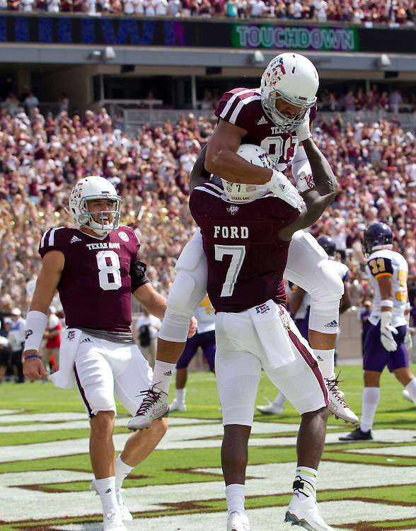 Texas A&M tight end Matthew Kirchner (88) jumps on to teammate Keith Ford (7) while celebrating a touchdown by Ford against Prairie View A&M during an NCAA college football game Saturday, Sept. 10, 2016, in College Station, Texas. Texas A&M won 67-0. (AP Photo/Sam Craft)