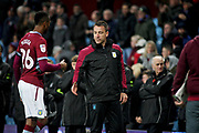 Aston Villa assistant manager John Terry congratulates Aston Villa forward Jonathan Kodjia (26) after the EFL Sky Bet Championship match between Aston Villa and Bolton Wanderers at Villa Park, Birmingham, England on 2 November 2018.