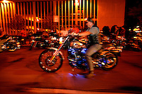 Harley Davidson bikers line the downtown streets to hang out and show off their bikes Thursday Aug. 28, 2003 Milwaukee. Thousands of Harley Davidson bikers from all over the world came to Wisconsin to help celebrate Harley Davidson 100th anniversary.   photo by Darren Hauck