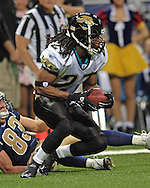 Jacksonville defensive back Rashean Mathis (27) turns up field after intercepting a St. Louis Rams pass in the first half at the Edward Jones Dome in St. Louis, Missouri, October 30, 2005.  The Rams beat the Jaguars 24-21.