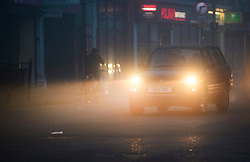 © Licensed to London News Pictures. 22/12/2016. London, UK. Traffic makes it's way along Ealing Broadway in thick fog on a cold winter morning. Temperatures over the upcoming Christmas period are expected to be unusually warm. Photo credit: Ben Cawthra/LNP