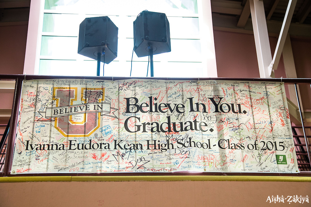 A banner signed by graduates, hangs in the auditorium where the commencement exercises will be held.  Ivanna Eudora Kean High School holds its 42nd Annual Commencement Exercise at Digna Marie Wheatley Gymnasium on 13 June 2015.  © Aisha-Zakiya Boyd